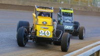 #20 Kody Swanson & #39 Matt Goodnight ride the inner guardrail in USAC Silver Crown action at the Illinois State Fairgrounds in 2020.