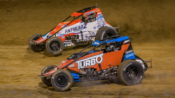 Brady Bacon (outside) and Tyler Courtney (inside) battle for the lead during Saturday night's Fall Nationals at Lawrenceburg (Ind.) Speedway.