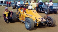 1982 USAC Silver Crown champion poses before the start of the Ted Horn 100 at the Du Quoin State Fairgrounds in Illinois.