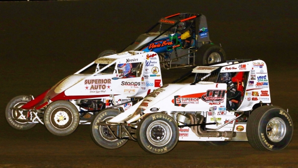 Isaac Chapple (inside) and Jarett Andretti (middle) tussle last season at Tri-State Speedway.