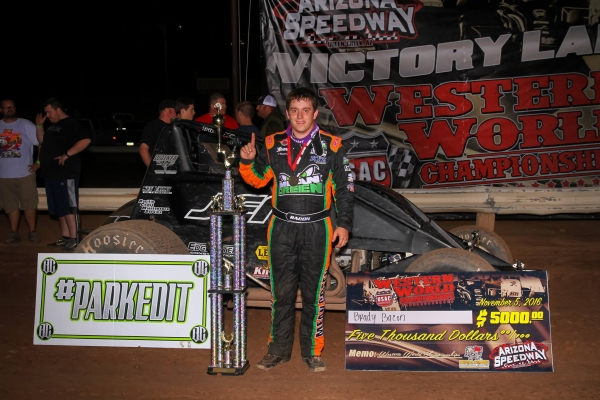 "Brady Bacon poses in victory lane after winning Saturday night's USAC Southwest Sprint Car ""Western World"" feature at Arizona Speedway."