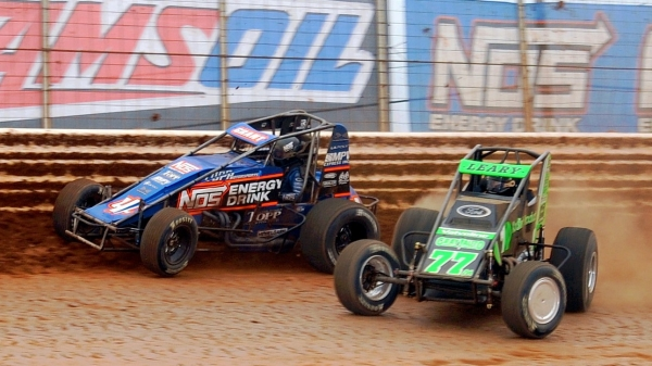 Eventual winner C.J. Leary (#77m) and Justin Grant (#4) battle for the lead during Saturday's USAC AMSOIL National Sprint Car feature at BAPS Motor Speedway.