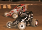 #73 Danny Sheridan and #4 Damion Gardner battle for the lead during a USAC/CRA Sprint Car race earlier in 2016.
