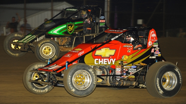 #20 Levi Jones goes side-by-side with Blake Fitzpatrick at Gas City (Ind.) I-69 Speedway in 2009.