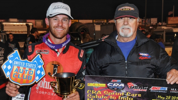 "Winning car owner Jack Jory (right) and winning driver Austin Williams (left) celebrate their ""Salute to Indy"" USAC CRA Sprint Car victory at Perris (Calif.) Auto Speedway on May 28, 2016."